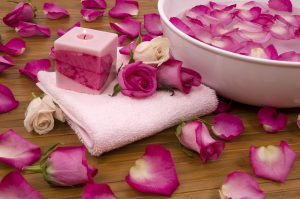 Spa Treatment with aromatic roses petals and candle